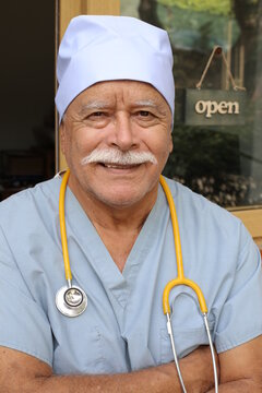 Senior health care worker with scrubs and stethoscope