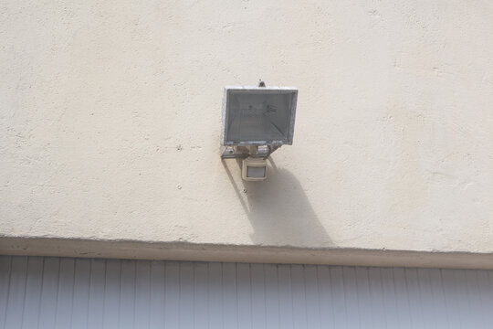 Outdoor floodlight on the wall of an house