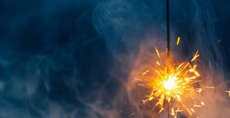 Fototapeta fire sparkler in dense smoke, abstract Christmas firework background obraz