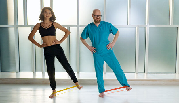 Physical Therapist Helps Relieve Back Pain Trauma Patient Suffering from Chronic Illness Through Exercise. Modern Rehabilitation.