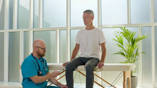 The Doctor Collects a Complete Medical History of Back Problems and Performs a Detailed Physical Examination. Physiotherapy Improves the Patient's Quality of Life.