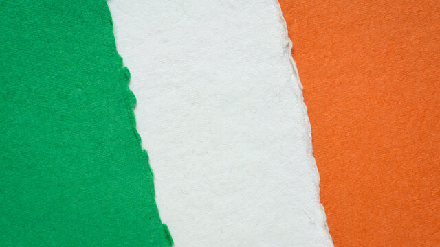 paper abstract in colors of national flag of Ireland (green, white and orange), collection of handmade rag paper sheets