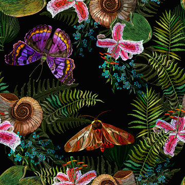 Embroidery tiger lilies and butterflies. Fashion seamless pattern. Tropical flowers orchids. Jungle template for clothes, textiles, t-shirt design