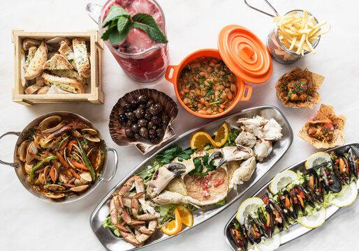 mixed spanish gourmet tapas sharing set selection on restaurant table