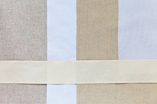 Various types of special cotton and linen canvas fabrics with square mesh in different sizes for hand embroidery and cross stitching. Empty space for text. DIY concept. Flat lay, top view, mock up