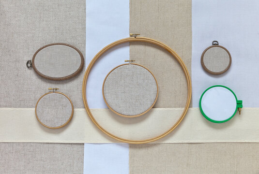 Various types of natural cotton and linen canvas with square meshes of different sizes for hand embroidery with a cross or long stitch and different types of hoops. Embroidery as a leisure and hobby