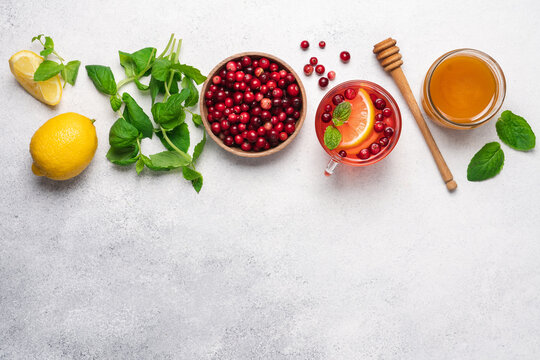 Hot tea with wild cranberries, lemon, honey and mint. Winter healthy drink for immunity boosting