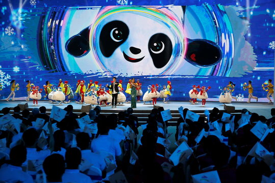 Singers perform on stage at a ceremony unveiling the slogan for Beijing 2022 Winter Olympics, in Beijing