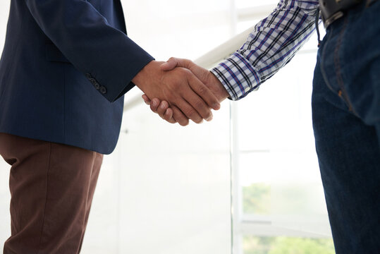 Close-up image of business people shaking hands to express trust and support