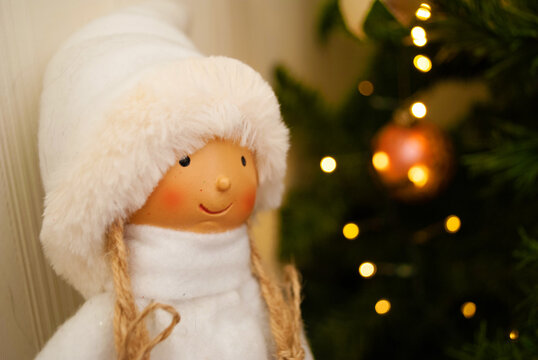 doll, girl in a fur coat and hat, snow maiden, Christmas decor, toys, bows, glass balls, bokeh, background, toys, merry christmas, happy new year. Lights, sparkles and highlights, snow, Christmas tree
