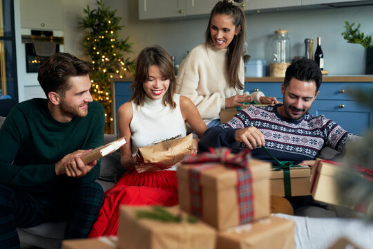 Friends and boxes with Christmas presents
