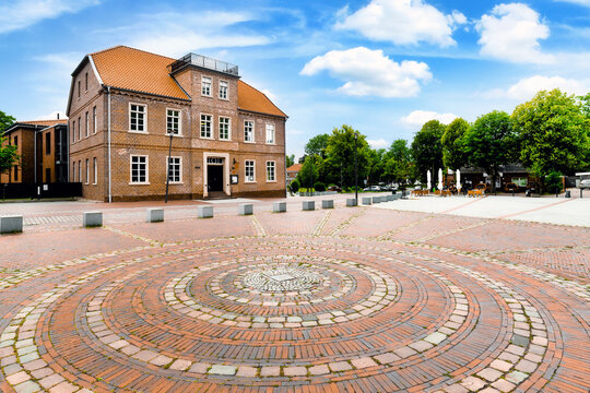 Town view Pewsum with traditional brick buildings, East Frisia, Germany