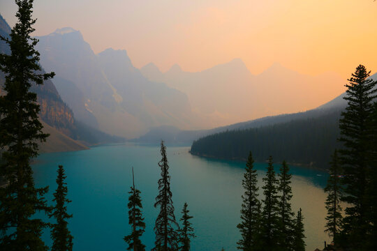 Iconic Moraine Lake in Banff National Park, Alberta, Canada.  Shot during the summer of 2021 it was hazy as a result of smoke from wildfires.