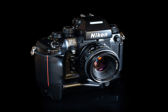Fukuoka, Japan - september 18, 2021 : Nikon F4 35 mm autofocus single lens reflex film camera designed by Giorgetto Giugiaro and released in 1988 with a 50mm F1.8 lens and a Battery Pack MB-21