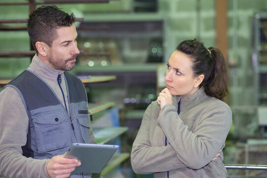 man and woman in factory