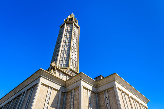 Le Havre, France - June 7, 2021: Low angle view of St Joseph church and its emblematic lantern tower, a modern catholic church made of concrete, built in 1957 after french architect Auguste Perret.