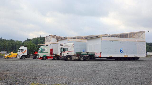 Three Oversize Load Transports and Pilot Vehicle