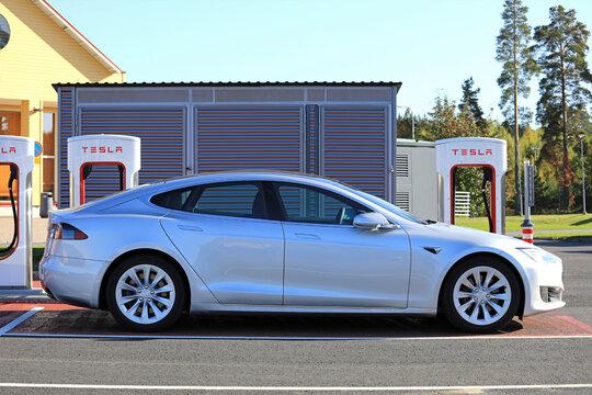 Silver Tesla Model S at Supercharger Charging Station