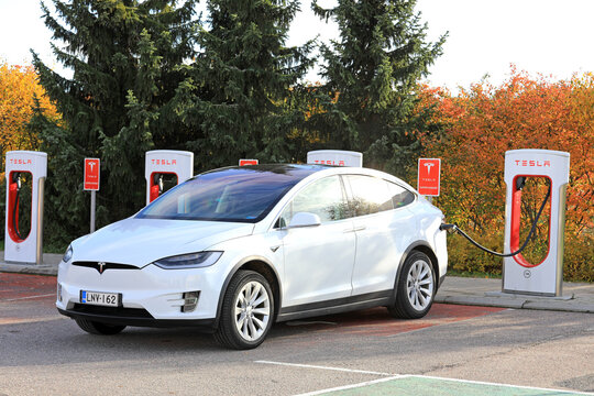 White Tesla Electric SUV Charging Battery.