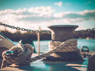 Fototapeta Rope knotted around steel pole for securing the boat obraz
