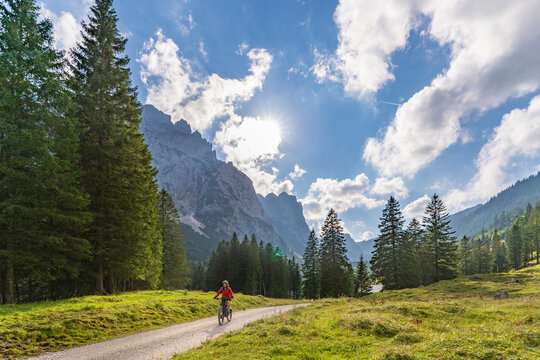 beautiful active senior woman with electric mountainbike in the spectacular Mountains of Raintal Valley, a side valley of Lechtal, Tyrol, Austria