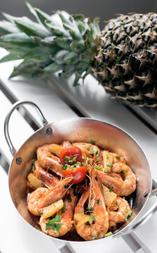spicy sauteed asian stir fry king prawns with pineapple