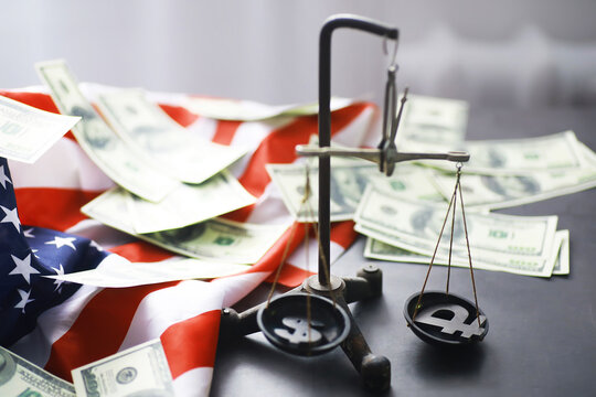 United States Law, scales of justice and American flag. Concept. Money.