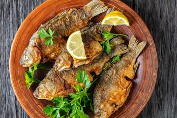 Obraz fried crucian carps with golden crispy crust - fototapety do salonu