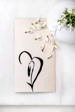 Bouquet of snowdrops flowers in white vase