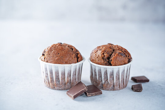 Sweet fresh chocolate muffins with chocolate slices
