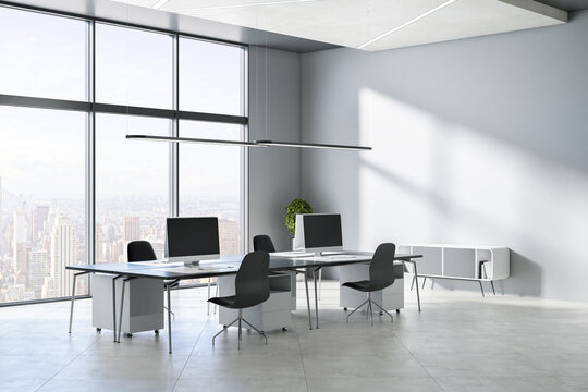 Modern concrete office interior with windows, city view, sunlight, equipment and furniture. 3D Rendering.