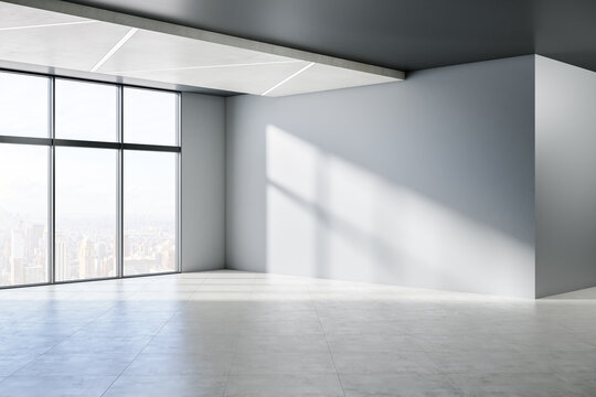 Minimalistic empty concrete room interior with windows, city view, sunlight and shadows. 3D Rendering.