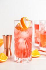 Fototapeta Glasses of tasty Negroni cocktail on light background obraz