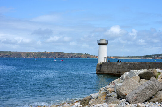 Camaret sur Mer, France, little ancient light house with view to the brittany coast