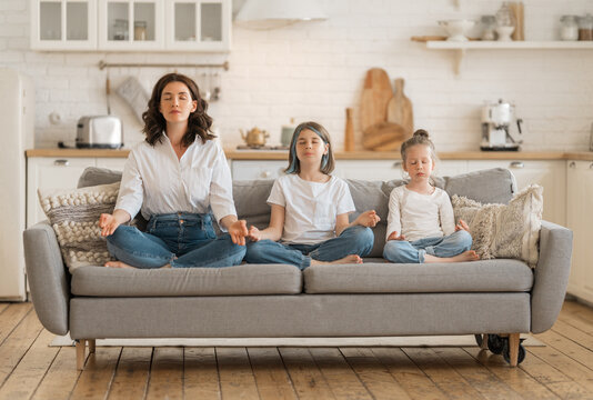 Woman and children are meditating
