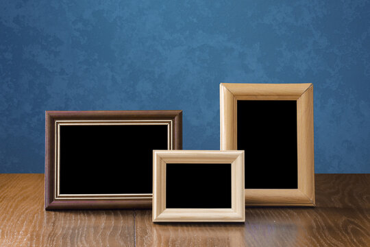 frames on table, blue wall