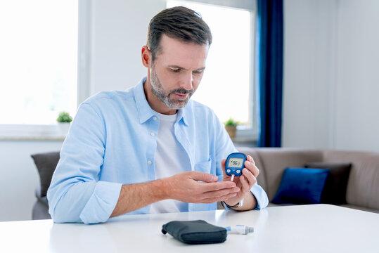 Man measures his blood sugar, diabetes concept