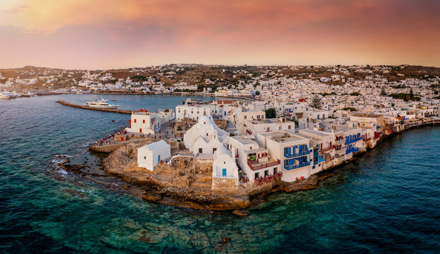 Aerial sunset view of the Paraportiani Church located within the whitewashed houses of Mykonos old town, Aegean Sea, Greece