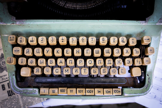 Antique typewriter cyrillic keys close up and russian keys selective focus
