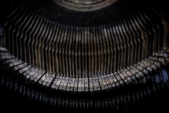 Close up of vintage typewriter, dirty typewriter metal parts with copy space