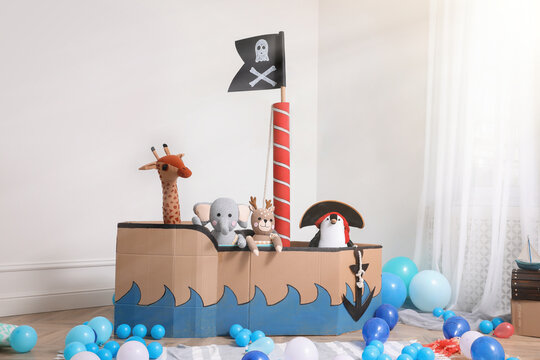 Child's room interior with pirate cardboard ship and toys