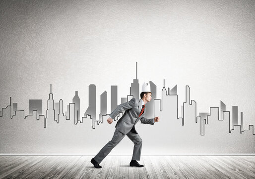 King businessman in elegant suit running and drawn cityscape silhouette at background