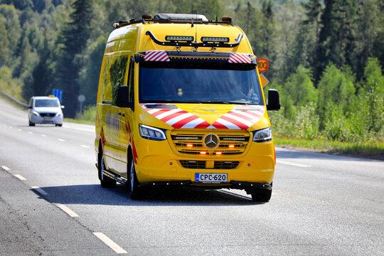 Mercedes-Benz Van Pilot Vehicle on Road.