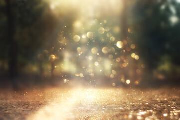 Obraz blurred abstract photo of light burst among lonely tree and glitter golden bokeh lights - fototapety do salonu
