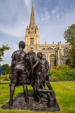 The Children of Calais Sculpture and St. Marys Church in Saffron Walden