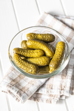 Small pickles. Marinated pickled cucumbers in bowl.