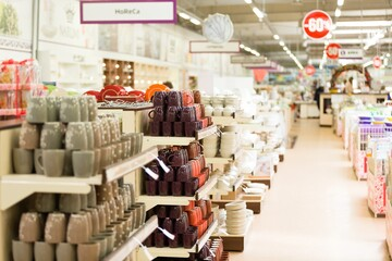 Obraz supermarket interior with collection of ceramic and tableware - fototapety do salonu