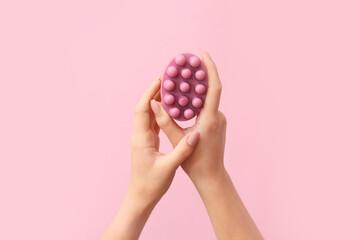 Fototapeta Female hands with massage soap bar on color background obraz