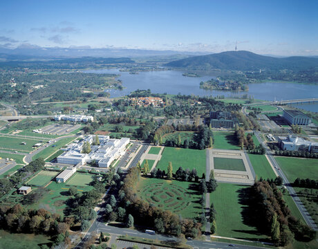Aerial view of the city of Canberra showing the old Parliament house and Lake Burley Griffin...