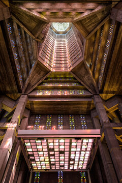 Le Havre, France - June 7, 2021: Low angle view of the interior of the lantern tower of St Joseph church, built in 1957 after Auguste Perret and illuminated through stained glass by Marguerite Hure.